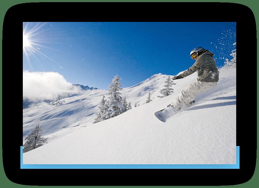 MANNI das Hotel Snowboarden im Sonnenschein